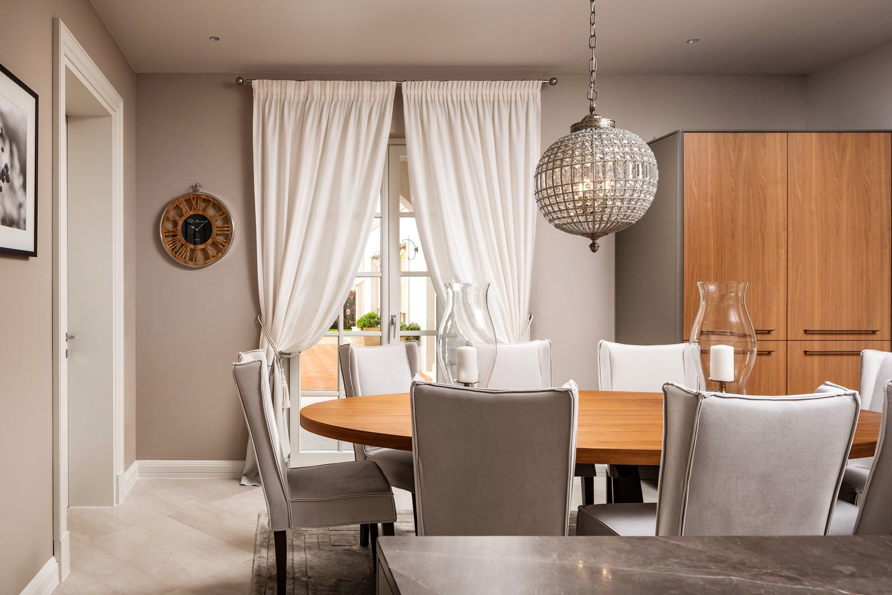 Large oval dining table near kitchen