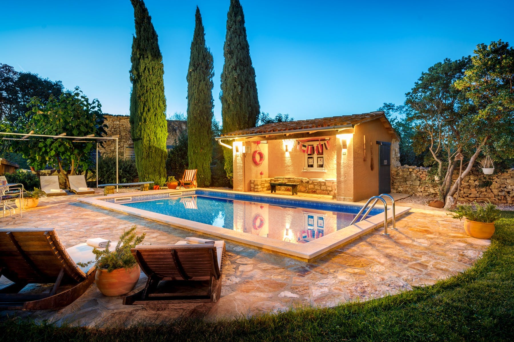 Carefully designed outside space with swimming pool, sundeck, and covered lounge area