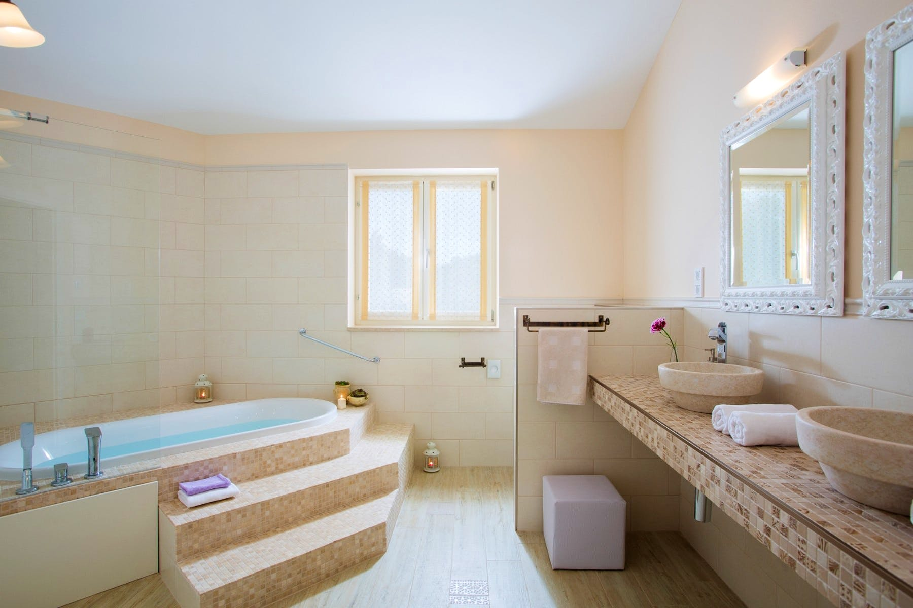 Spacious bathroom with whirlpool tub and double sink