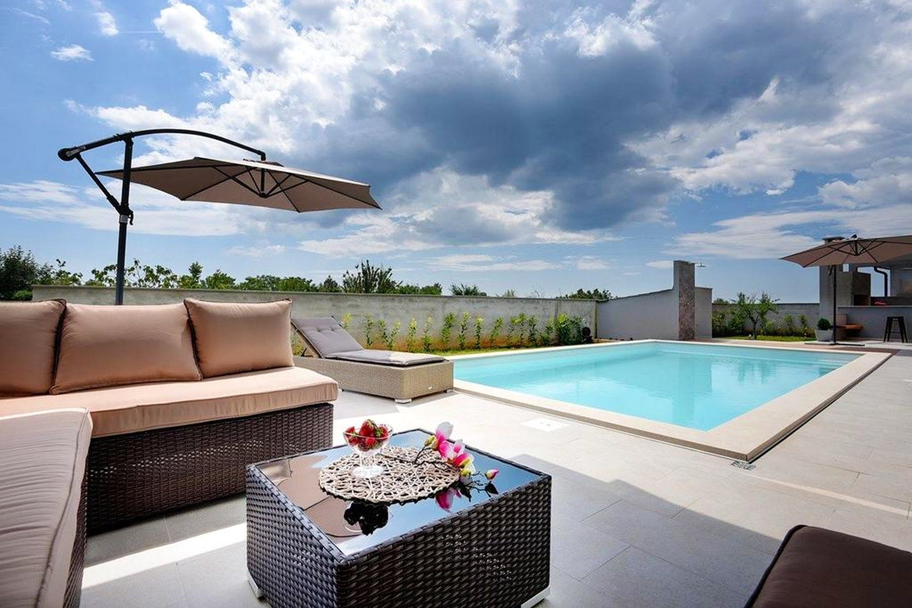 Spacious terrace with swimming pool and sun deck