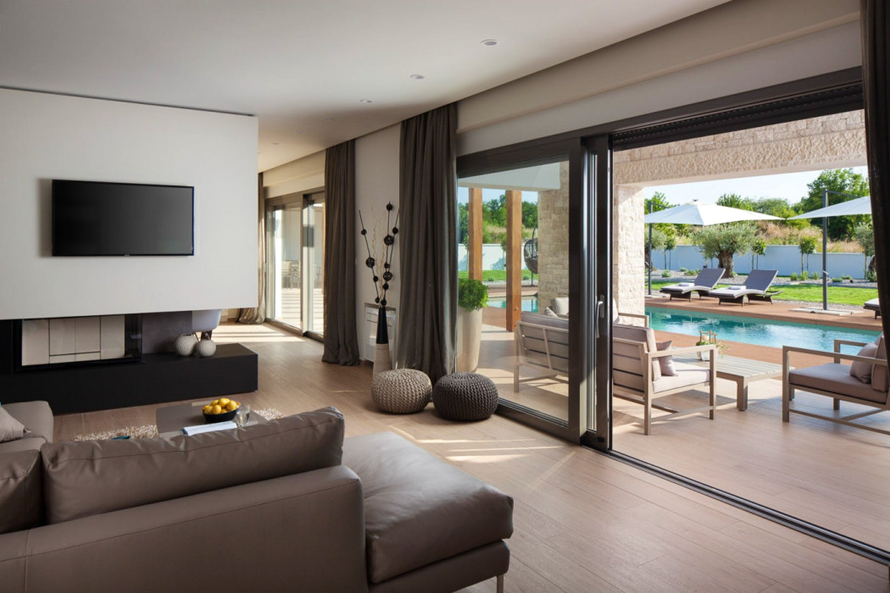 Open plan living area with the access to the terrace and swimming pool