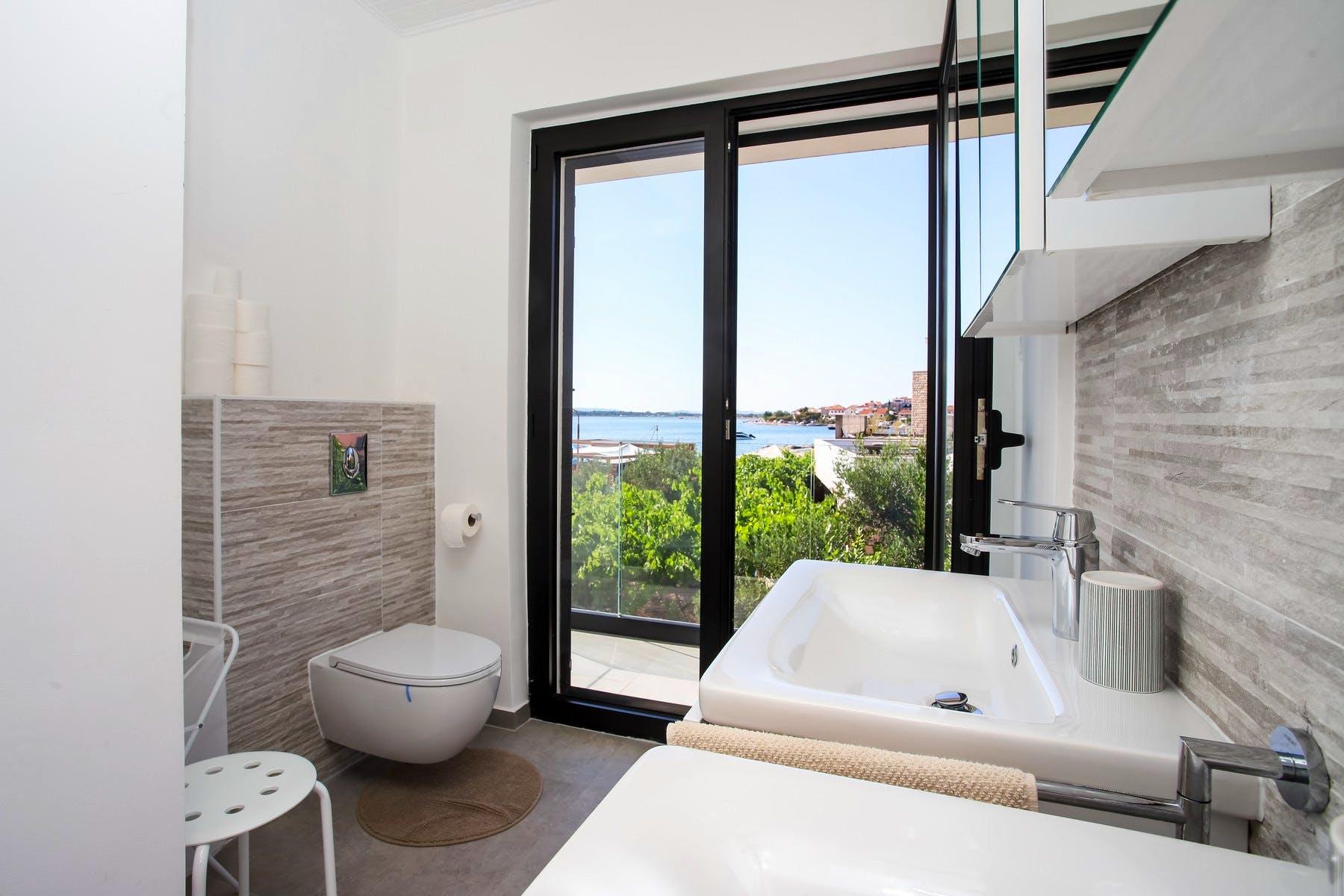 Modern bathroom with sea view