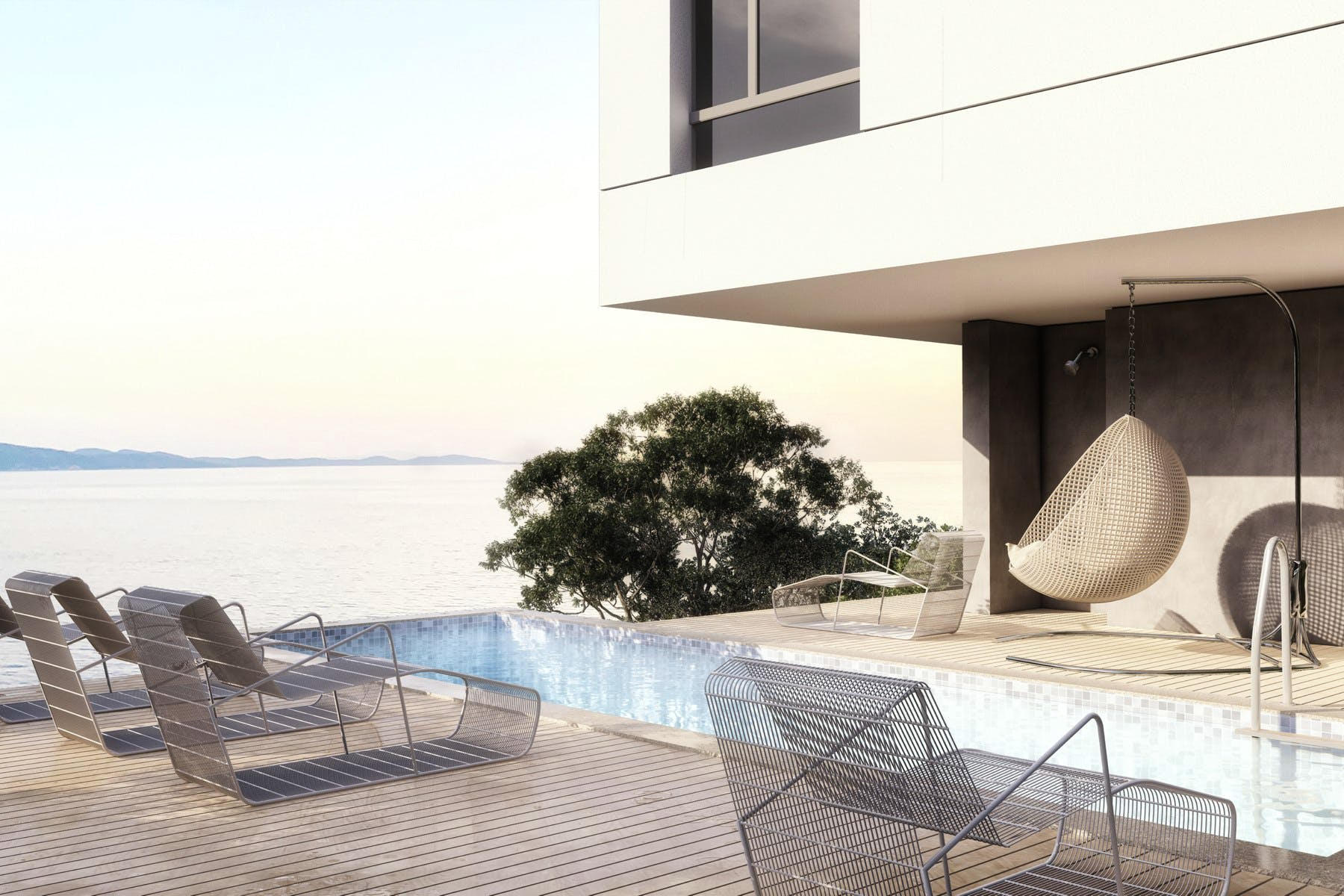 Spacious terrace with swimming pool, sun deck, lounge area and sea view