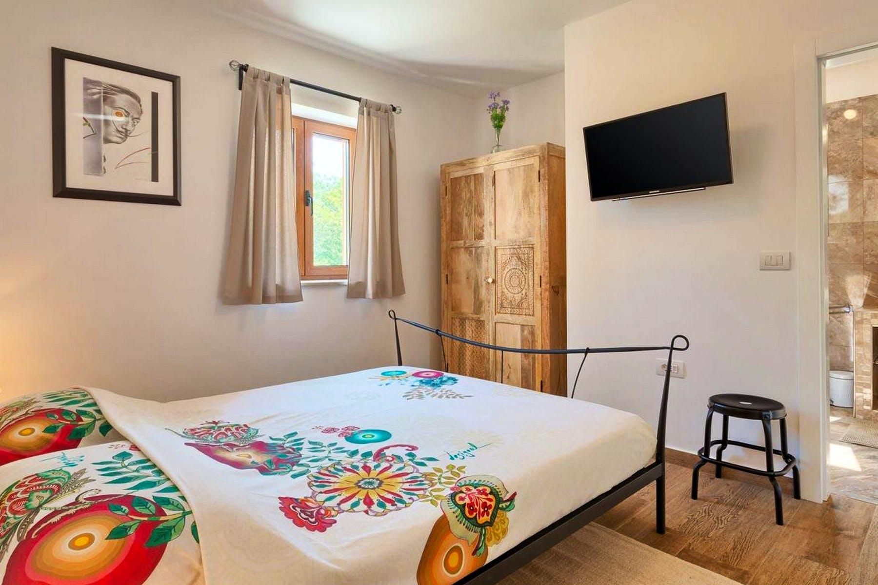 En-suite bedroom with double bed