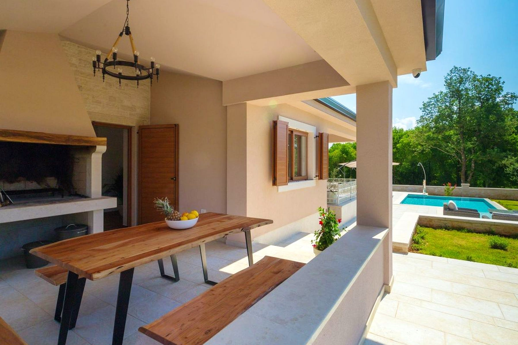 Outside dining area with stone barbecue