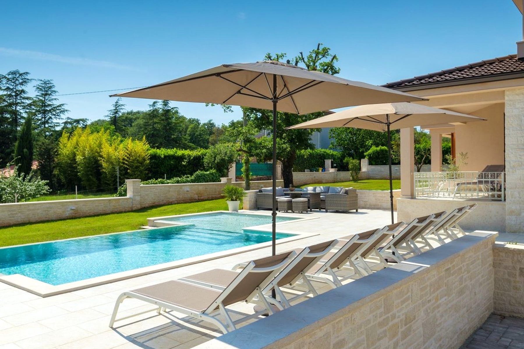 Outside area with swimming pool, sundeck and lounge zone