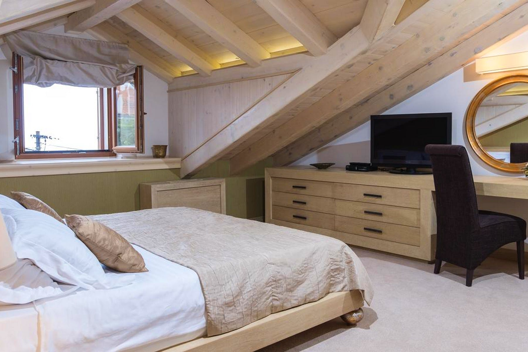 Double bedroom enhanced by traditional wood beams