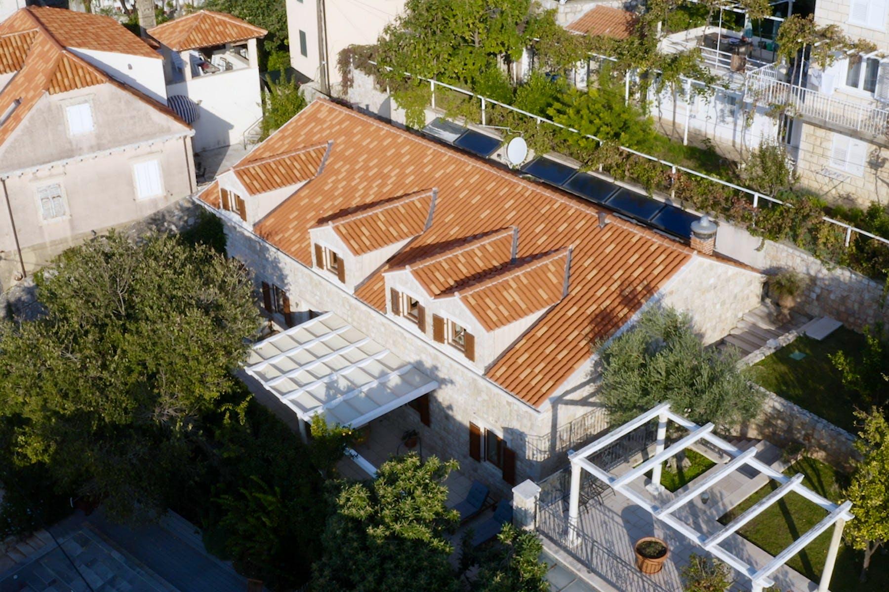 Unique stone villa surrounded by lush Mediterranean garden