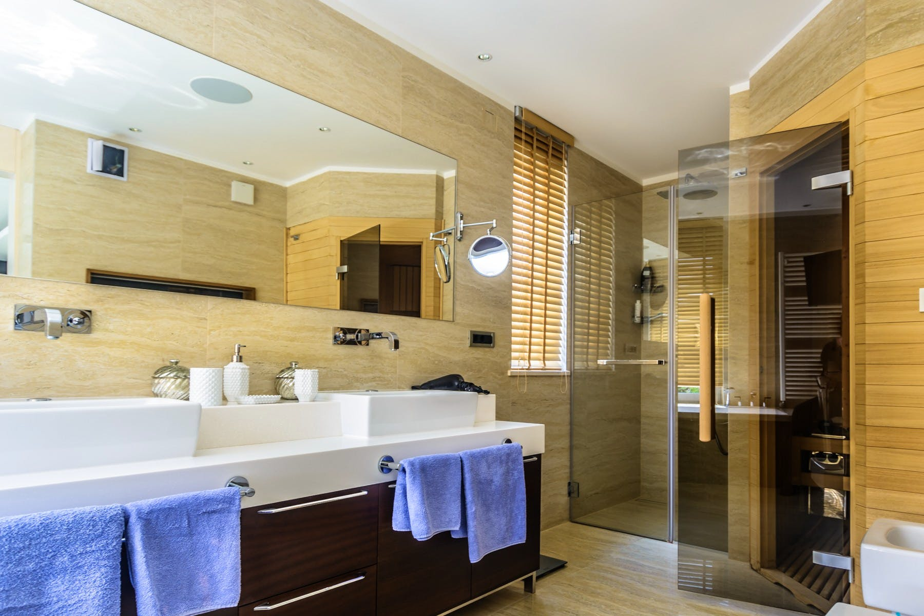 Spacious modern master bathroom with walk in shower and sauna