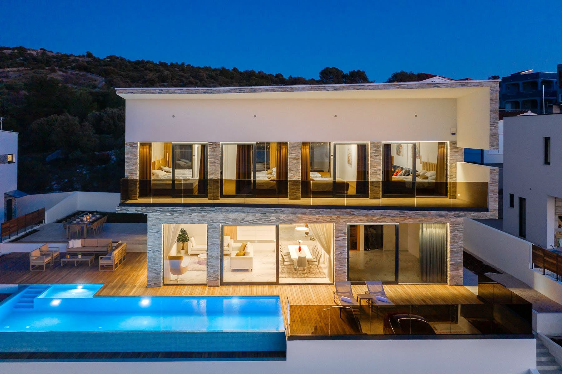 Night ambiance of luxury villa with swimming pool