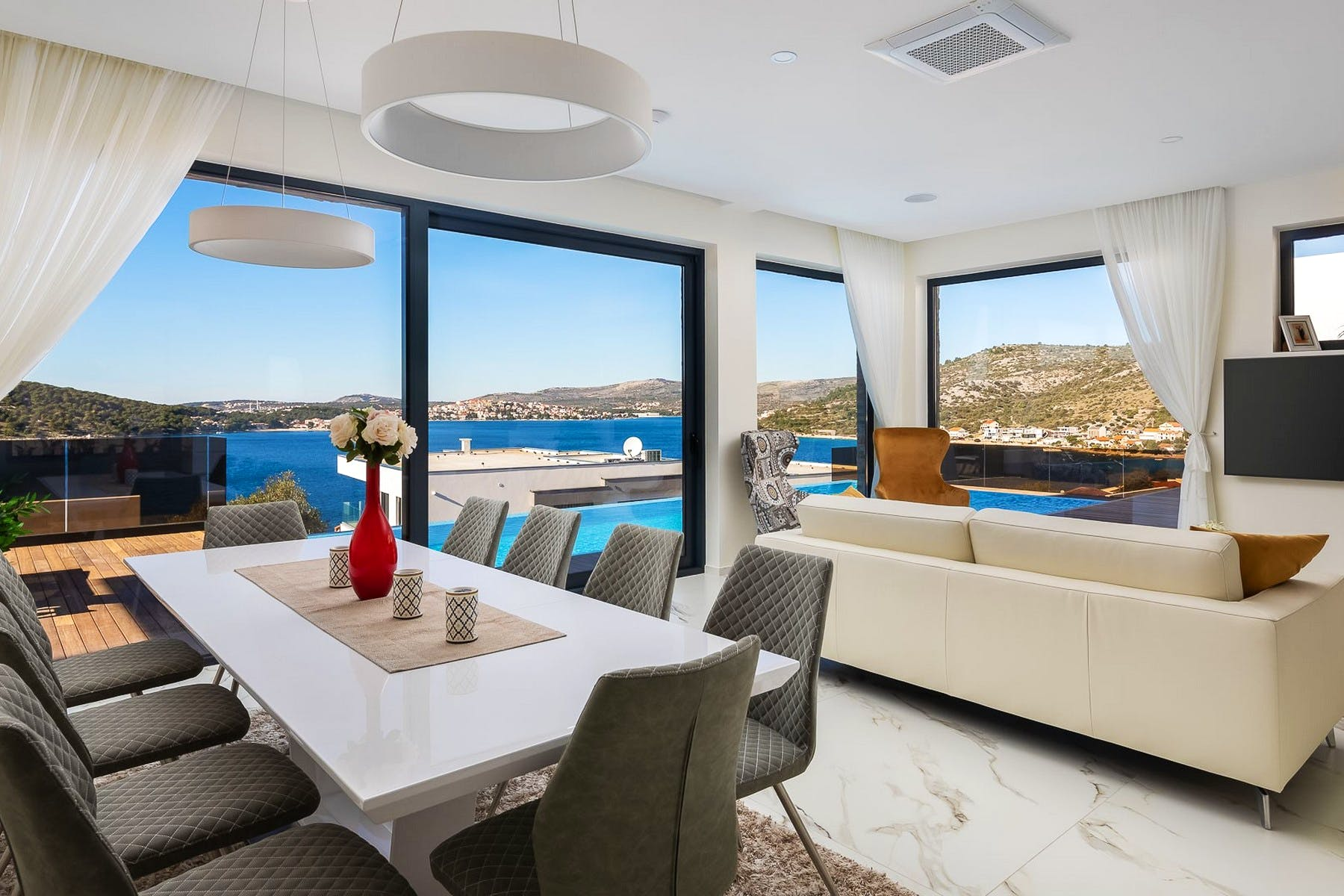 Open plan living area with idyllic sea view