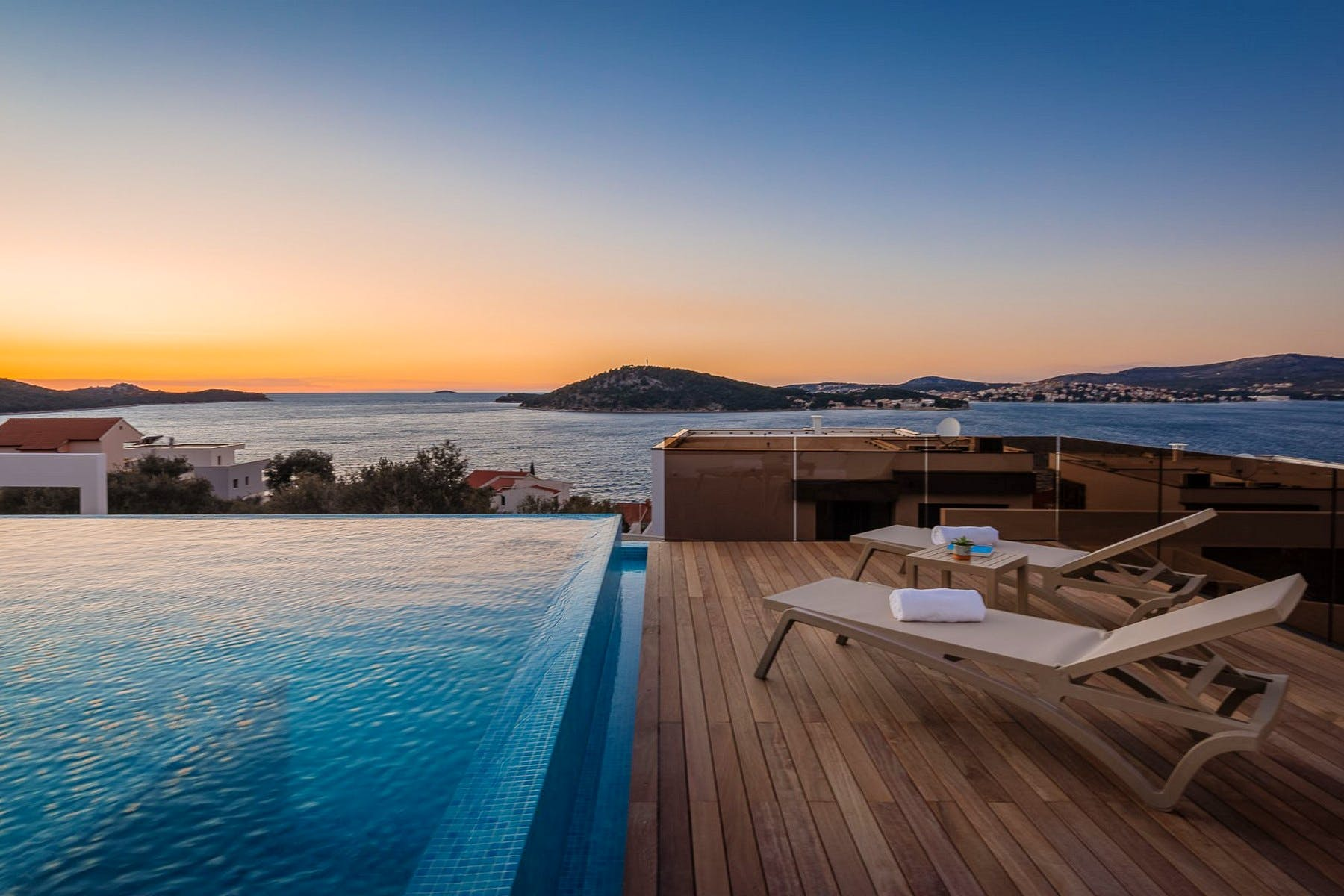 Night ambiance and sunset view from the terrace with swimming pool